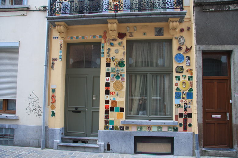 Photos of the house displaying the ceramic art facade