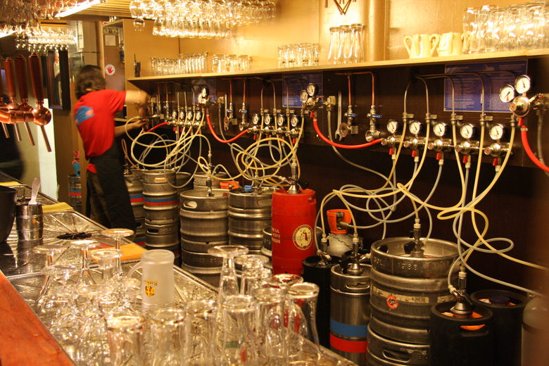 e large number of kegs connected to bar taps Delirium cafe