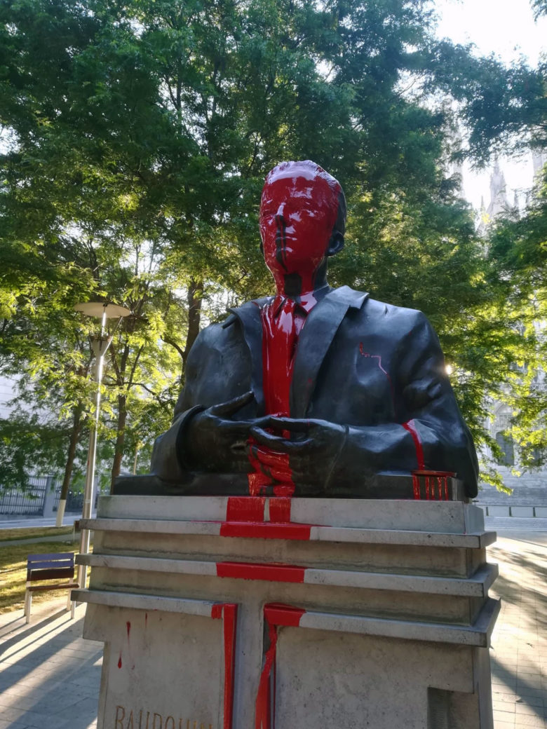 Red paint covers the statue of King Baudouin in Brussels
