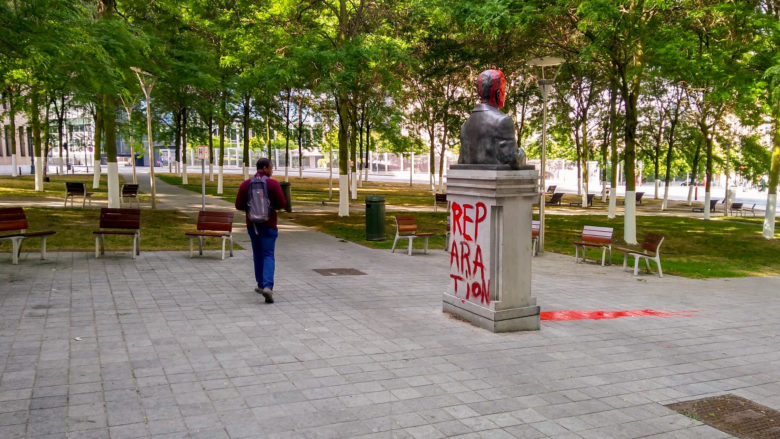 King Baudouin statue tagged with the words REPARATIONS