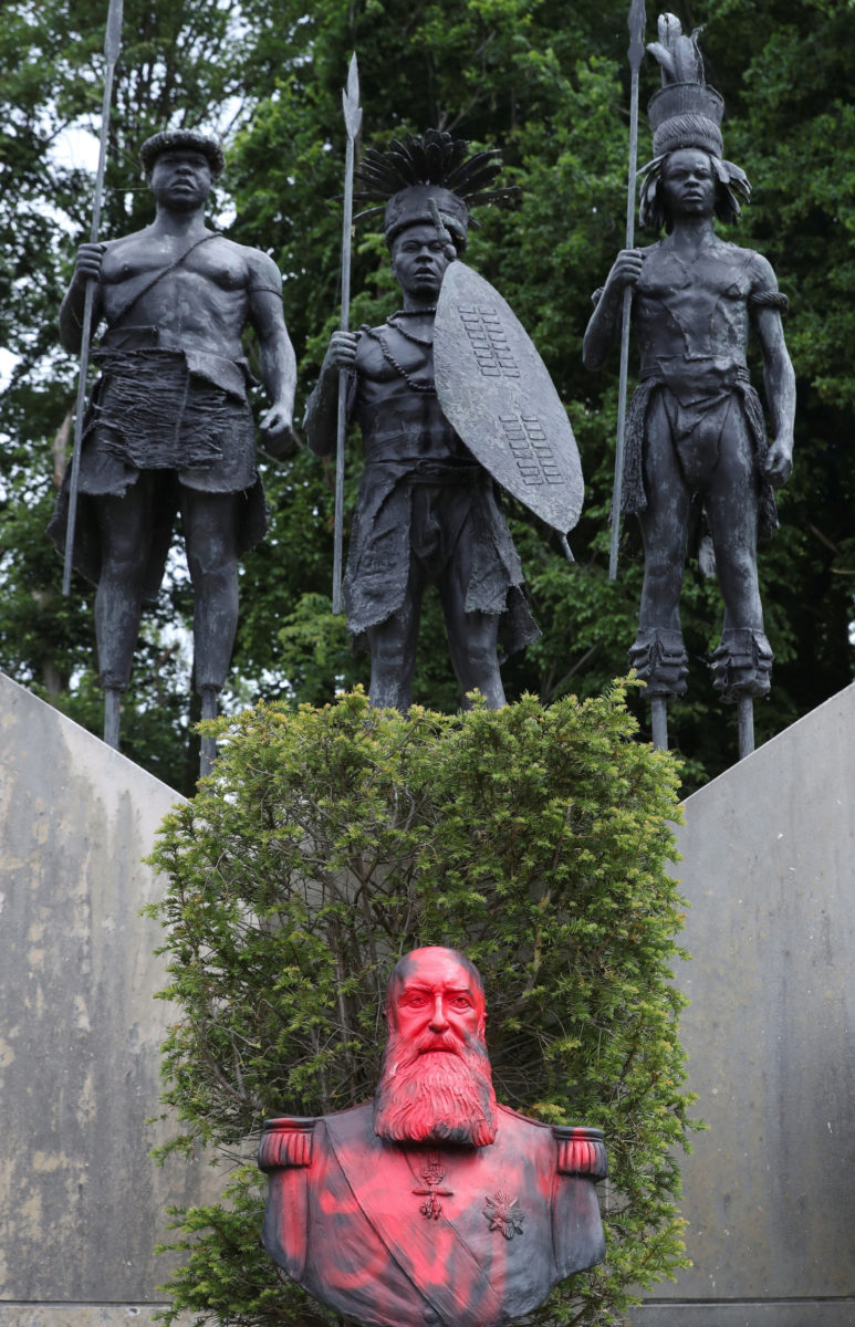 A statue of Leopold II vandalized in the garden of the Museum of Africa
