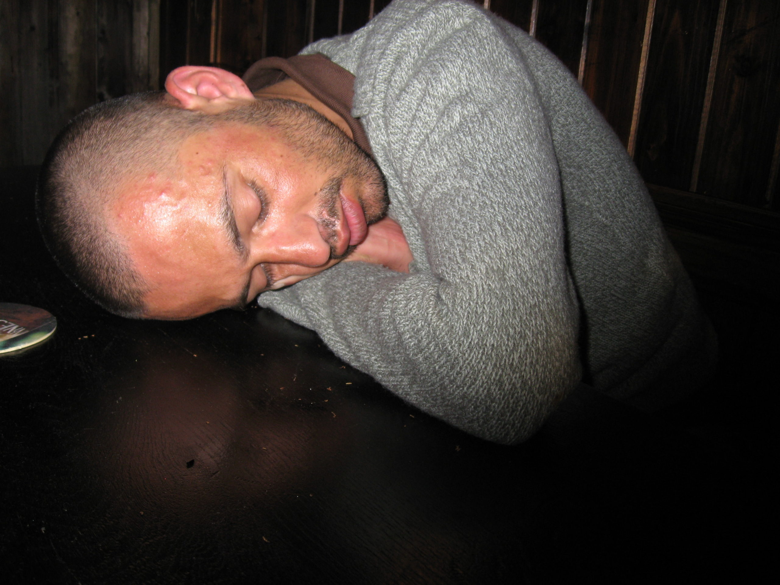 Sleeping on a table in Celtica pub drunk Brussels