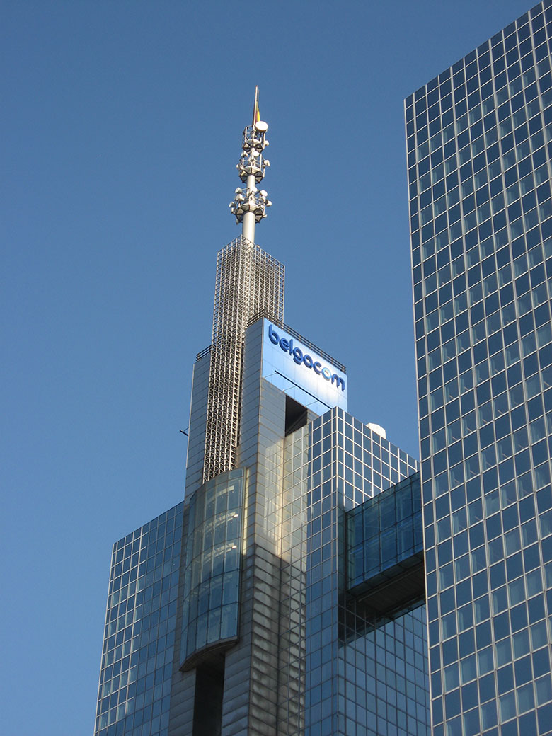 The peak of the Belgacom towers with its company logo and antenna